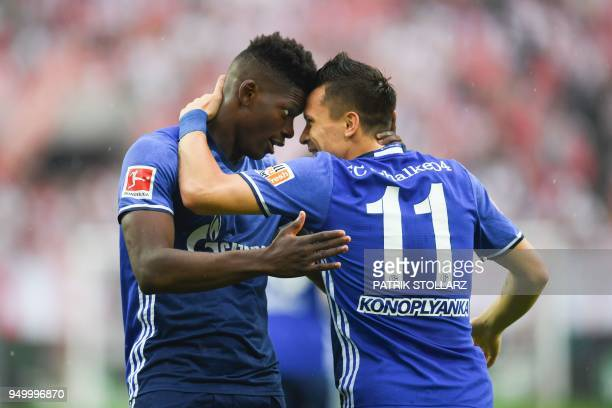Schalke's Swiss forward Breel Embolo and teammate Ukrainian midfielder Yevhen Konoplyanka celebrate after scoring during the German first division...