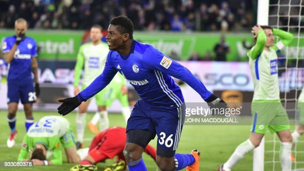 Schalke's Swiss forward Breel Embolo celebrates after an own goal by Schalke during the German First division Bundesliga football match VfL Wolfsburg...
