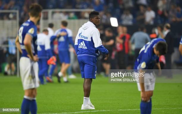 Schalke's Swiss forward Breel Embolo reacts after the German Cup DFB Pokal semifinal football match Schalke 04 vs Eintracht Frankfurt in...
