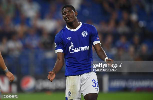 Schalke's Swiss forward Breel Embolo reacts during the UEFA Champions League group D football match FC Schalke 04 v FC Porto in Gelsenkirchen western...
