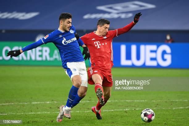 Schalke's Turkish defender Ozan Kabak and Bayern Munich's Polish forward Robert Lewandowski vie for the ball during the German first division...