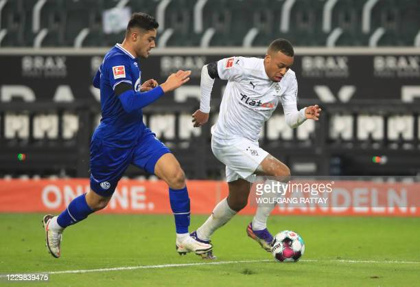 Schalke's Turkish defender Ozan Kabak and Moenchengladbach's French forward Alassane Plea vie for the ball during the German first division...