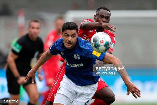 Schalke's Turkish defender Ozan Kabak and Union Berlin's Nigerian forward Anthony Ujah vie for the ball during the German first division Bundesliga...