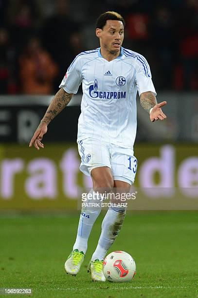 Schalke's US midfielder Jermaine Jones kicks the ball during the German first division Bundesliga football match Bayer Leverkusen vs FC Schalke 04 in...