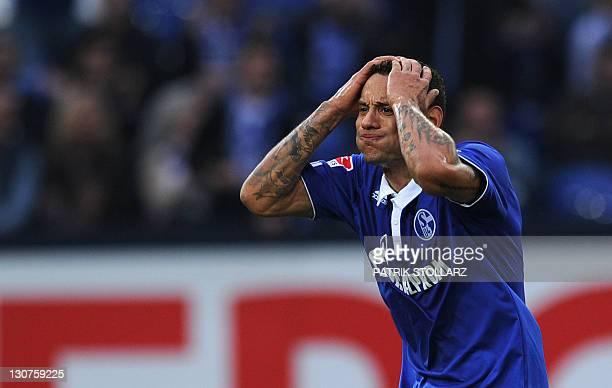 Schalke's US midfielder Jermaine Jones reacts during the German first division Bundesliga football match FC Schalke 04 vs. 1899 Hoffenheim in the...