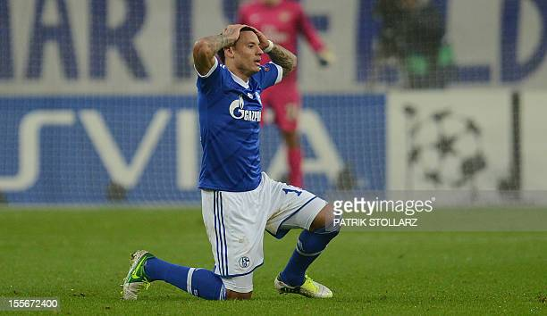 Schalke's US midfielder Jermaine Jones reacts during the UEFA Champions league group B football match between Schalke 04 and Arsenal in Gelsenkirchen...