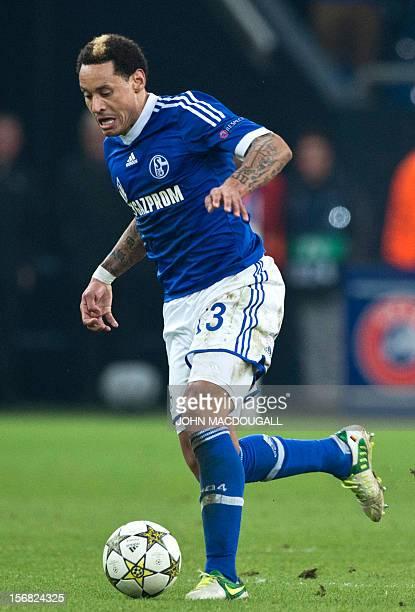 Schalke's US midfielder Jermaine Jones runs with the ball during the UEFA Champions League Group B football match Schalke 04 vs Olympiacos in...