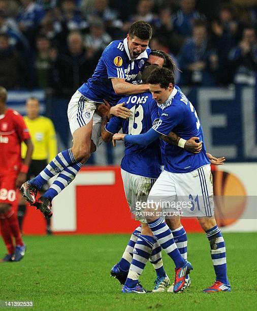Schalke's US midfielder Jermaine Jones Schalke's Dutch striker KlaasJan Huntelaar and Schalke's midfielder Julian Draxler celebrate during the...