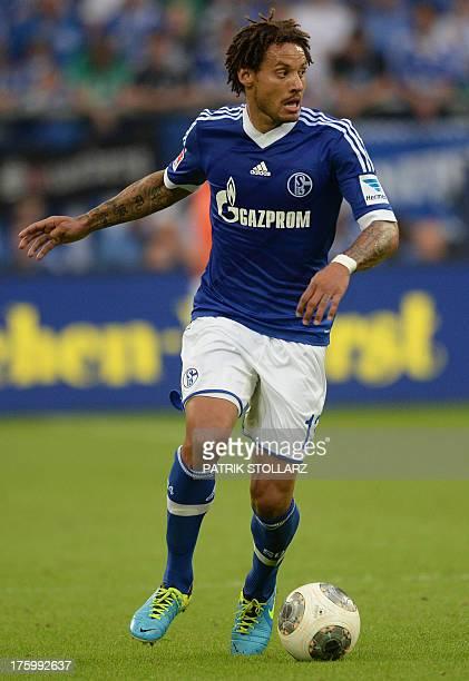 Schalke's US midfielder Jermaine Jones vies for the ball during the German first division Bundesliga football match FC Schalke 04 vs Hamburger SV in...