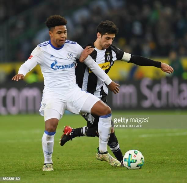 Schalke's US midfielder Weston McKennie and Moenchengladbach's German forward Lars Stindl vie for the ball during the German first division...