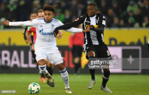 Schalke's US midfielder Weston McKennie and Moenchengladbach's Swiss midfielder Denis Zakaria vie for the ball during the German first division...