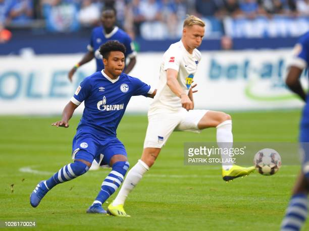 Schalke's US midfielder Weston McKennie and SBerlin's German midfielder Arne Maier vie for the ball during the German first division Bundesliga...