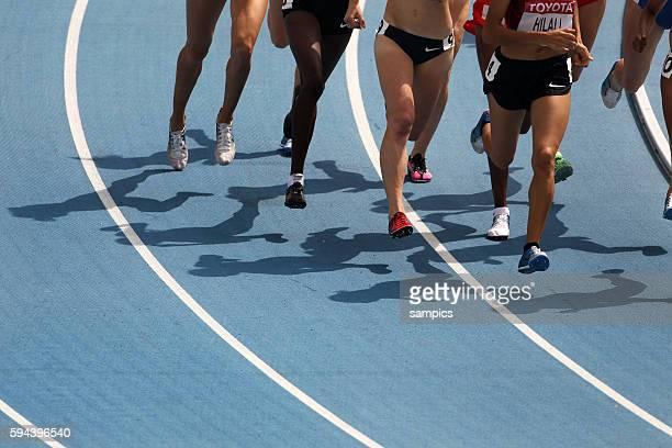 Schattenspiel auf der Laufbahn IAAF Leichtathletik WM Weltmeisterschaft in Daegu Sudkores 2011 IAAF world Championship athletics in Daegu South Korea...