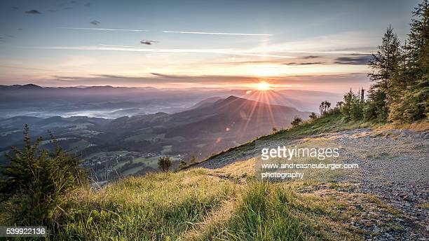 schöckl sunrise - view to north east - graz stock photos and pictures