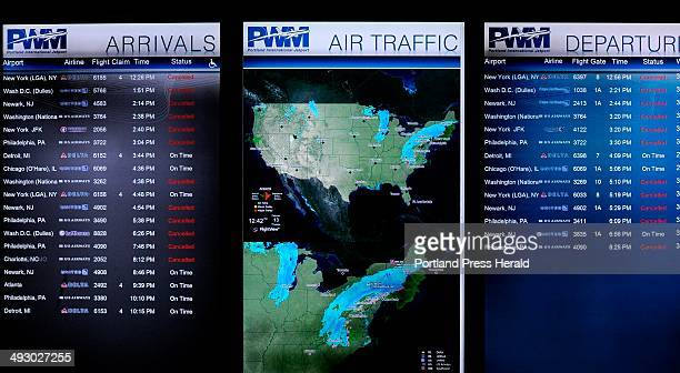 Schedule board shows cancellations and radar view of the East Coast storm during the noon hour at the Portland Jetport Thursday February 13 2014