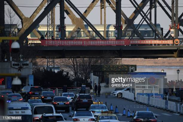 A scheduled passenger train arrives from North Korea on the SinoKorean Friendship Bridge to the Chinese border city of Dandong in China's northeast...