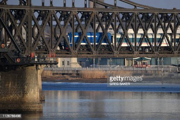 A scheduled passenger train crosses the SinoKorean Friendship Bridge from North Korea to the Chinese border city of Dandong in China's northeast...