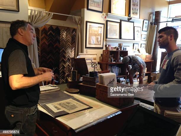 Schein Schein antique map shop owner Jimmie Schein talks to a customer about the early development of San Francisco's North Point