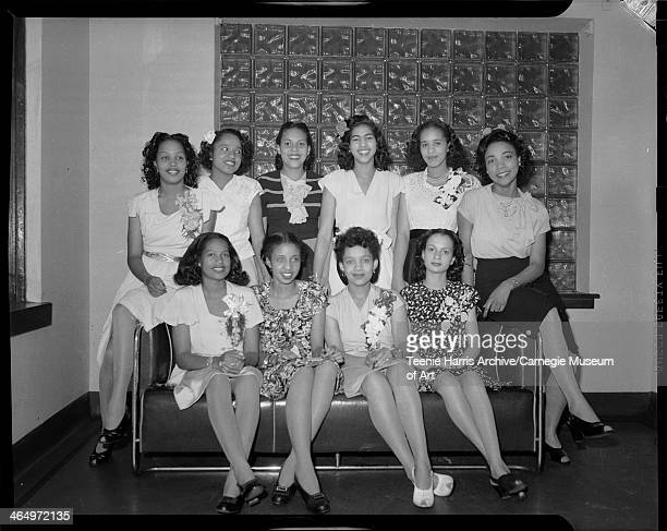 Schenley High School graduates posed in Loendi Club Pittsburgh Pennsylvania June 1945 Seated from left Juanita Taylor Doris Clark Eugenia Scott...