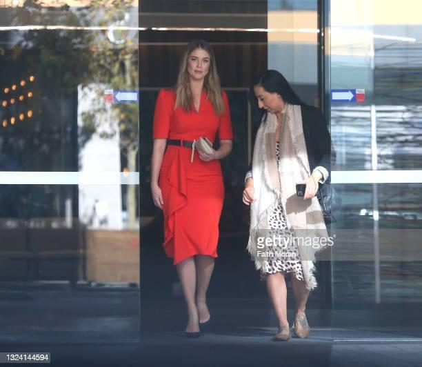 Scherri-Lee Biggs and friend Nelly are seen leaving the HBF building in Perth on June 18, 2021 in Perth, Australia.
