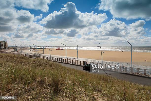 scheveningen boulevard on a partly clouded day - boulevard stock pictures, royalty-free photos & images