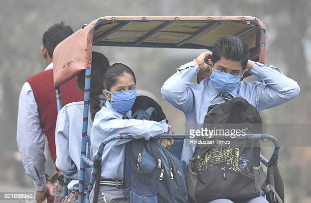 Schhol going children wear masks to protect themselves from the toxic Delhi NCR air at Mayur Vihar phase III on November 7 2016 in New Delhi India A...