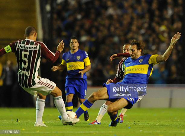 Schiavi of Boca Juniors tries to steal the ball from Edinho of Fluminense during a match as part of the Santander Libertadores Cup at Alberto J...
