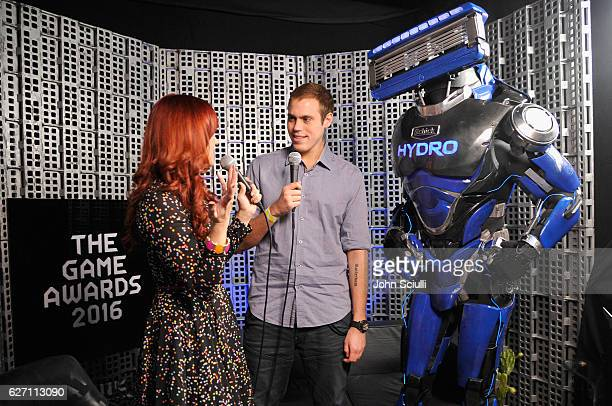 Schick Hydro's superhero, Hydrobot, backstage with Kevin van der Kooi at The Game Awards on December 1, 2016 in Los Angeles, California.