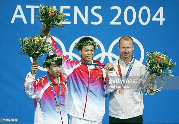 Schiessen Olympische Spiele Athen 2004 Athen Luftgewehr 10m / Maenner / Finale Jie LI / CHN / Silber Qinan ZHU / CHN / Gold Josef GONCI / SVK /Bronze...