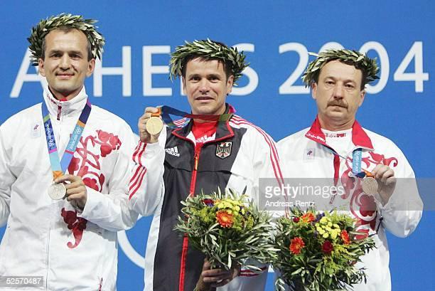 Schiessen Olympische Spiele Athen 2004 Athen Schnellfeuerpistole 25m / Maenner Silber Sergei POLIAKOV / RUS GOLD Ralf SCHUHMANN / GER Bronze Sergei...