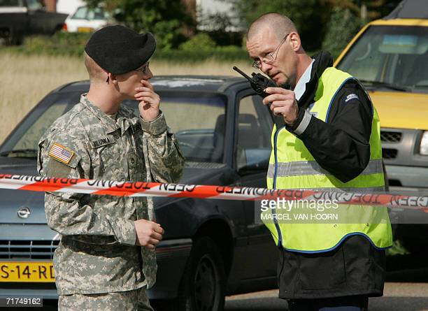 An American soldier and a police officer confer 30 August 2006 at a US military base near Schinnen in the Netherlands The US base was sealed off...