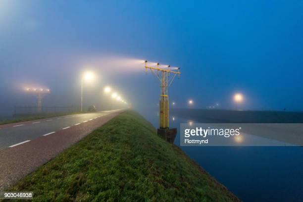 Schiphol runway and fog, Netherlands