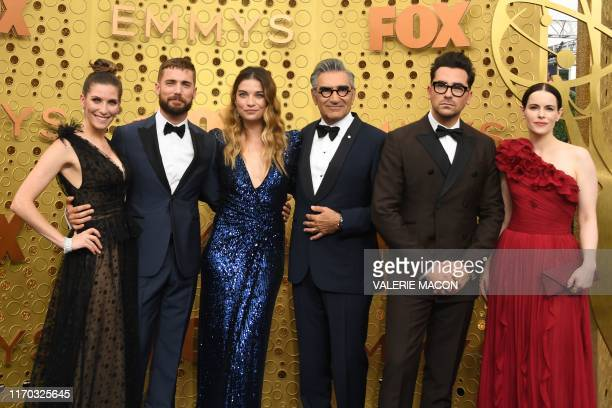 """""""Schitt's Creek"""" cast members arrive for the 71st Emmy Awards at the Microsoft Theatre in Los Angeles on September 22, 2019."""