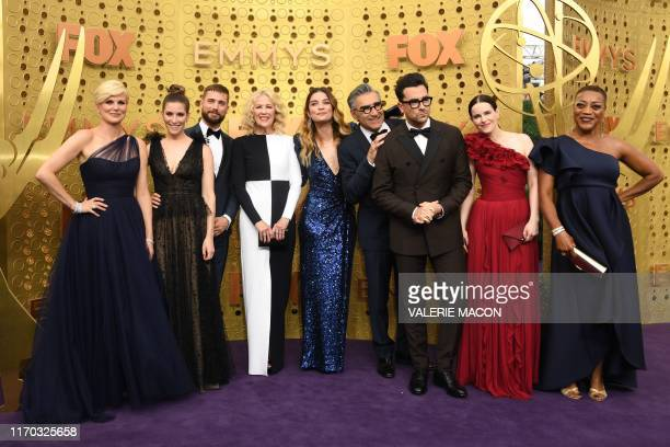 """Schitt's Creek"""" cast members arrive for the 71st Emmy Awards at the Microsoft Theatre in Los Angeles on September 22, 2019."""