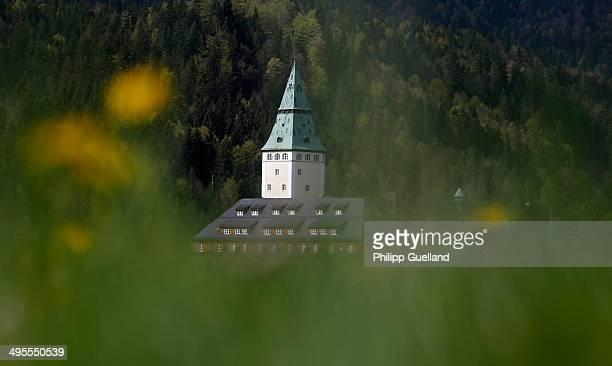 Schloss Elmau, a luxury spa hotel, stands in the Bavarian Alps of southern Germany on May 8, 2014 in Kruen near Garmisch-Partenkirchen, Germany....