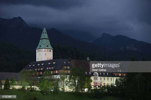 Schloss Elmau venue of the summit of the G7 group of nations stands illuminated under dark clouds on the first day of the summit on June 7 2015 near...