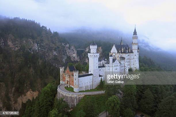 Schloss Neuschwanstein castle as well as Schloss Hohenschwangau stand in this aerial view in the early morning on June 11 2015 near Hohenschwangau...