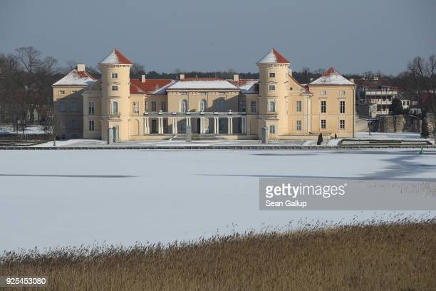Schloss Rheinsberg palace stands at the edge of frozen Grienericksee lake in Brandenburg state on February 28 2018 in Rheinsberg Germany Schloss...