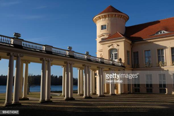 Schloss Rheinsberg palace stands at the edge of Grienericksee lake in Brandenburg state on March 18 2018 in Rheinsberg Germany Schloss Rheinsberg...