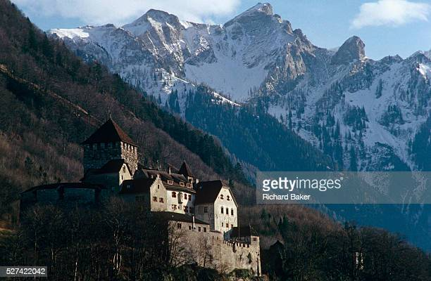 Schloss Vaduz perches high on the slopes above Vaduz the capital of the tiny landlocked Principality of Liechtenstein Prince HansAdam II is the...