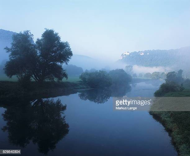 Schloss Werenwag Castle reflecting in Danube River, Danube Valley, Upper Danube Nature Park, Swabian Alb, Baden Wurttemberg, Germany, Europe