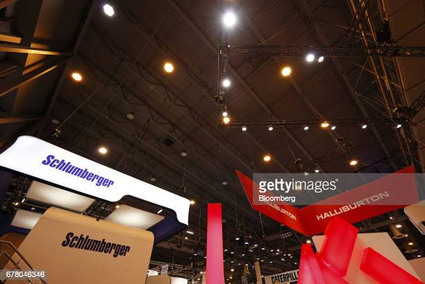 Schlumberger Ltd And Halliburton Co Signage Is Displayed Above The Company Booths During 2017 Offshore