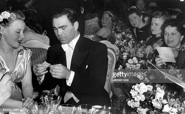Schmeling Max Sportsman Boxer Businessman Germany*Max Schmeling and his wife actress Anny Ondra at the Filmball 1939 1939 Photographer Erich Engel...