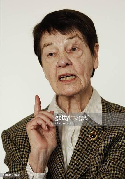 Schmidt Hannelore 'Loki' Teacher Botanist Germany with warning finger