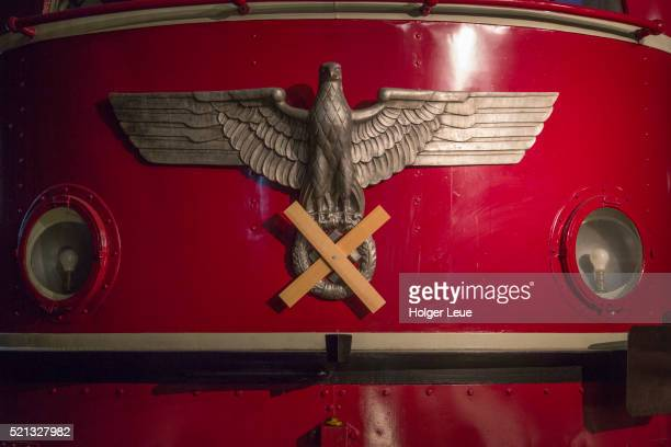 schnellzug-lokomotive e 19 12 with covered swastika symbol on display at db museum train museum - nazism stock pictures, royalty-free photos & images