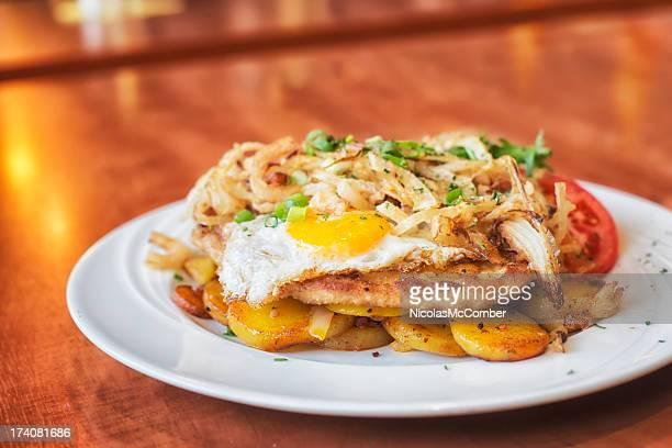 Schnitzel with egg and fried onions