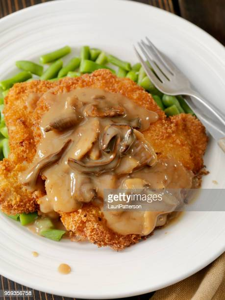 schnitzel with mushroom sauce and green beans - gravy stock pictures, royalty-free photos & images