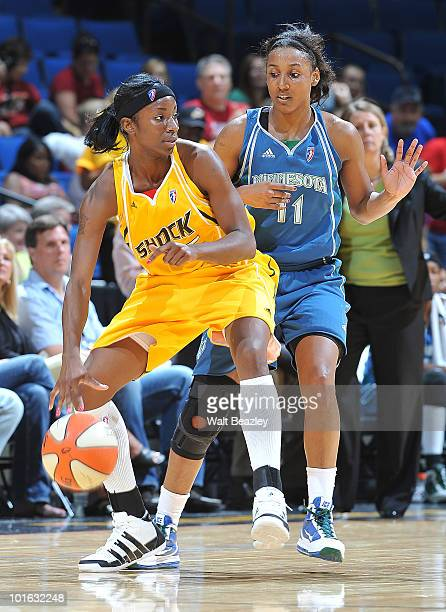 Scholanda Robinson of the Tulsa Shock handles the ball defended by Candice Wiggins of the Minnesota Lynx at the Bok Center June 4 2010 in Tulsa...