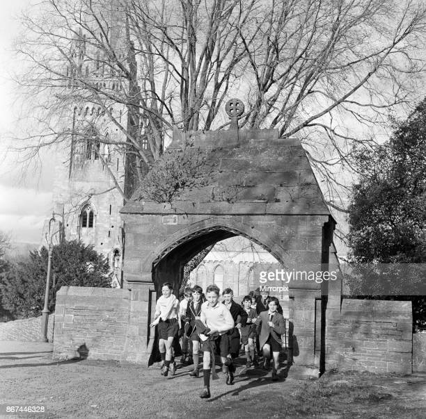 Scholars and choirboys of Llandaff Cathedral South Wales on their way to play rugby 1st March 1954