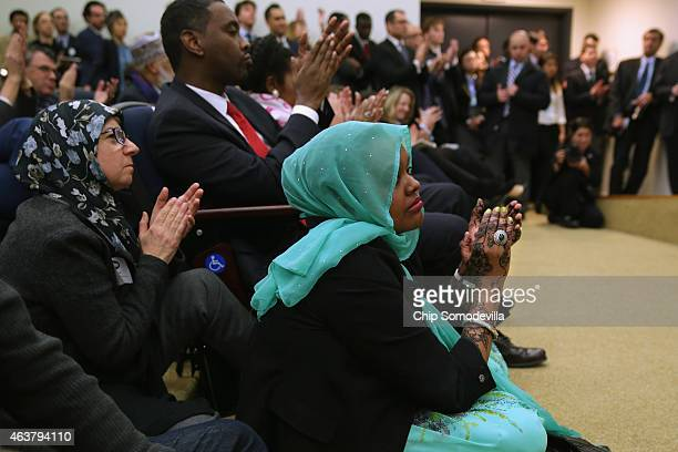 Scholars teachers politicians law enforcement officers and others attending the White House Summit on Countering Violent Extremism applaud during...